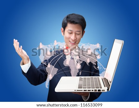 Business man Looking at a social network structure on laptop