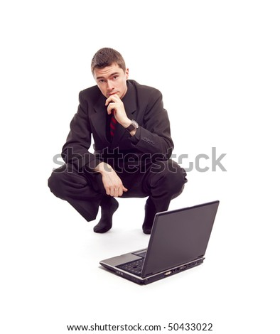 business man looking at laptop over white
