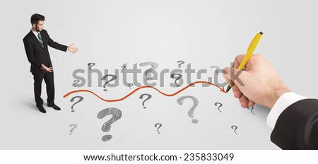 Business man looking at question marks and solution path concept drawn by hand - stock photo