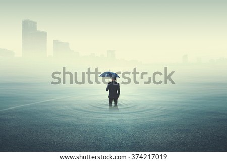 business man looking at the city underwater - stock photo
