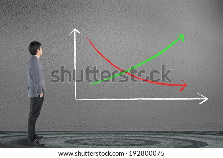 Business man looking demand and supplies graph  - stock photo