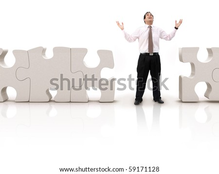 Business man looking for the pieces of a puzzle- isolated over white