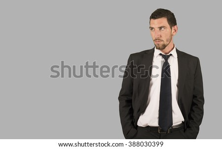 Business man looking in grey background