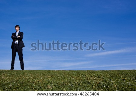 Business man looking out over a hillside - stock photo