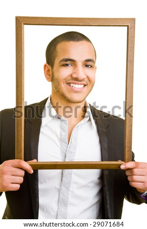 Business man looking through an empty frame - stock photo
