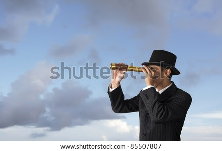 business man looks through a telescope - stock photo