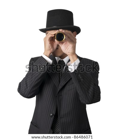 business man looks through a telescope isolated on white