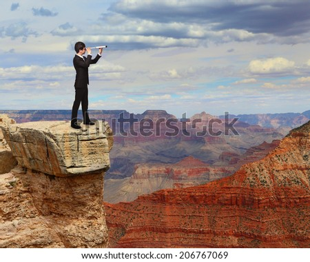 business man looks through a telescope on the top mountain. concept for business, leadership, success, - stock photo