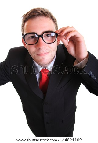 Business man looks up and smiles wearing retro eyeglasses - stock photo
