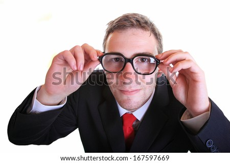 Business man looks up and smiles wearing retro eyeglasses