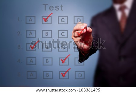 business man make choice on test result form - stock photo