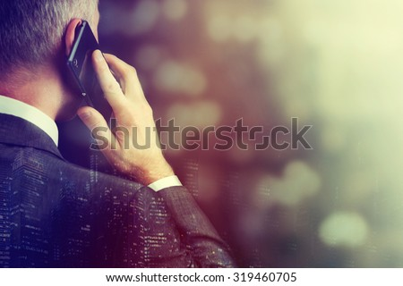 Business man making a phone call with smartphone. - stock photo