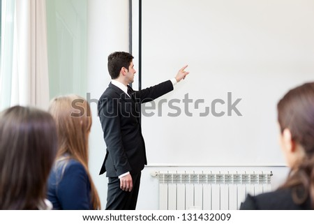 Business man making a presentation at the office - stock photo