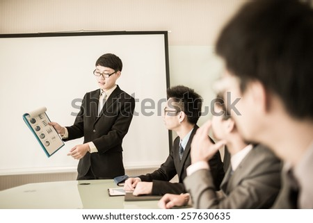 Business man making a presentation at the office.Asian - stock photo