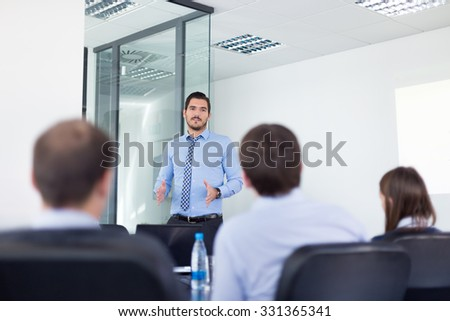 Business man making a presentation in office on job interview. Business presentation on corporate meeting. Recruiters evaluating the candidate.  - stock photo