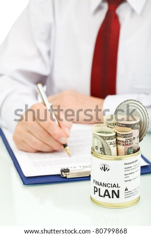 Business man making financial plan with an opened can of US dollars