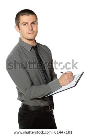 Business man making notes  on a clipboard. - stock photo