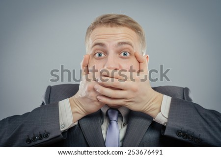 business man making the speak no evil gesture  - stock photo