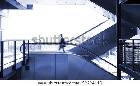 business man moving on escalator - stock photo