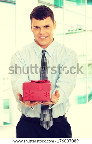 Business man offering a gift  - stock photo