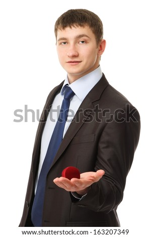 Business man offering a gift, isolated on white background - stock photo