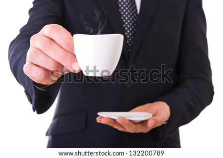 Business man offering cup of coffee. - stock photo