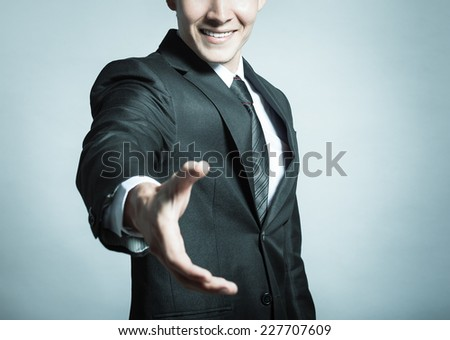 Business man offering for handshake - stock photo