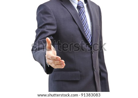 Business man offers his hand ready to seal a deal isolated on white - stock photo
