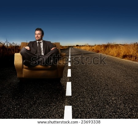 business man on armchair on the street - stock photo
