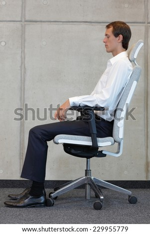 business man on chair in correct sitting position - resting - stock photo