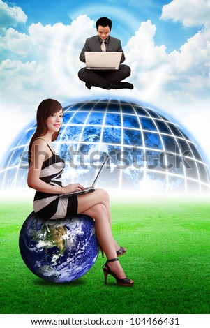 Business man on digital world and lady on globe : Elements of this image furnished by NASA
