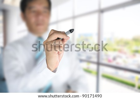 Business man on office background - stock photo