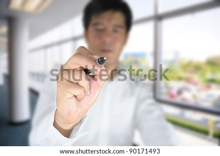 Business man on office background