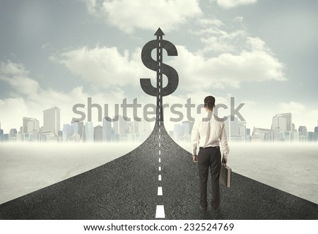 Business man on road heading toward a dollar sign concept - stock photo