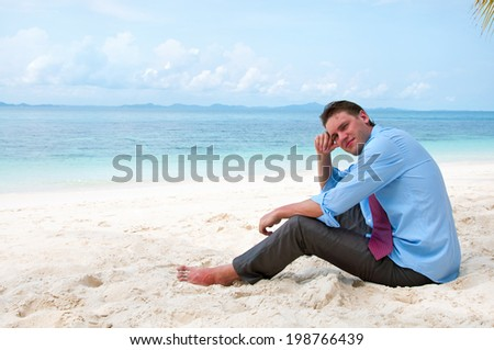 Business man on the beach  - stock photo