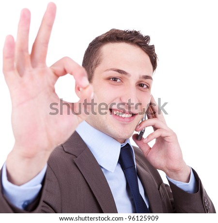 business man on the phone approving the good news on white background - stock photo