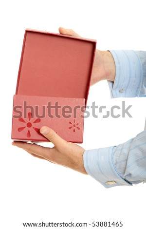 Business man opening a gift over a white background - stock photo