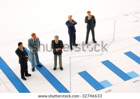 business man over economic chart in conversation - stock photo