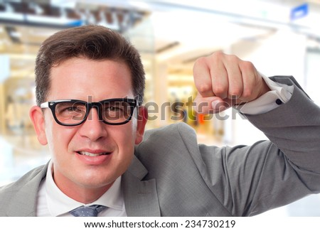 Business man over shopping center background. Looking upset - stock photo