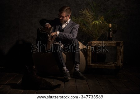 Business man Packing something in bag at home while sitting on beanbag