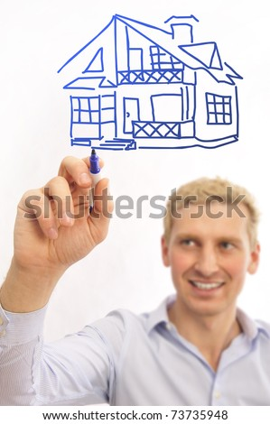 business man painting big family house on a transparent touchscreen with his marker. Mortgage concept - stock photo