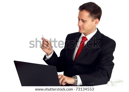 Business man paying online with his credit card - stock photo