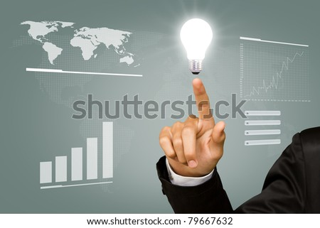 Business man point light bulb in his hand - stock photo