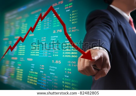 Business man point to falling graph of stock market - stock photo