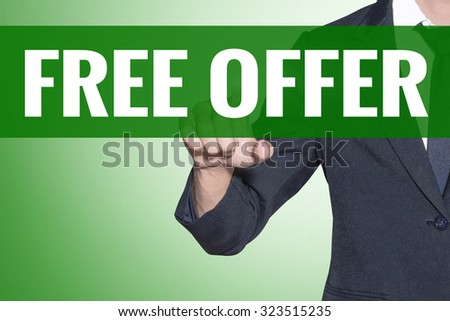 Business man point to Free Offer word on green tab virtual screen - stock photo