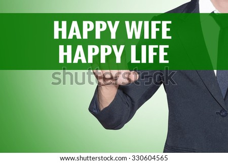 Business man point to Happy Wife Happy Life word on green tab virtual screen - stock photo