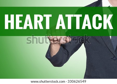 Business man point to Heart Attack word on green tab virtual screen - stock photo