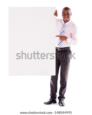 Business man pointing at a banner - isolated over white - stock photo