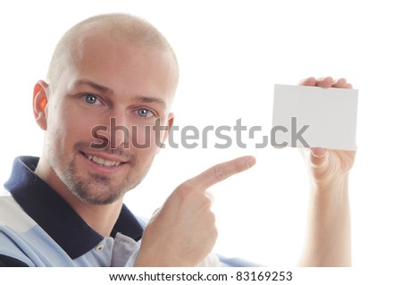 Business man pointing at a blank business card over white background - stock photo