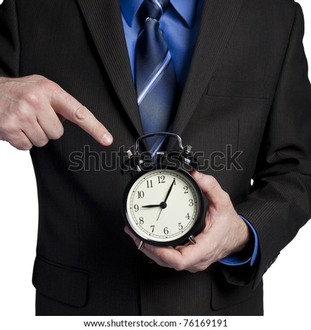 business man pointing at clock showing you are 5 minutes late - stock photo